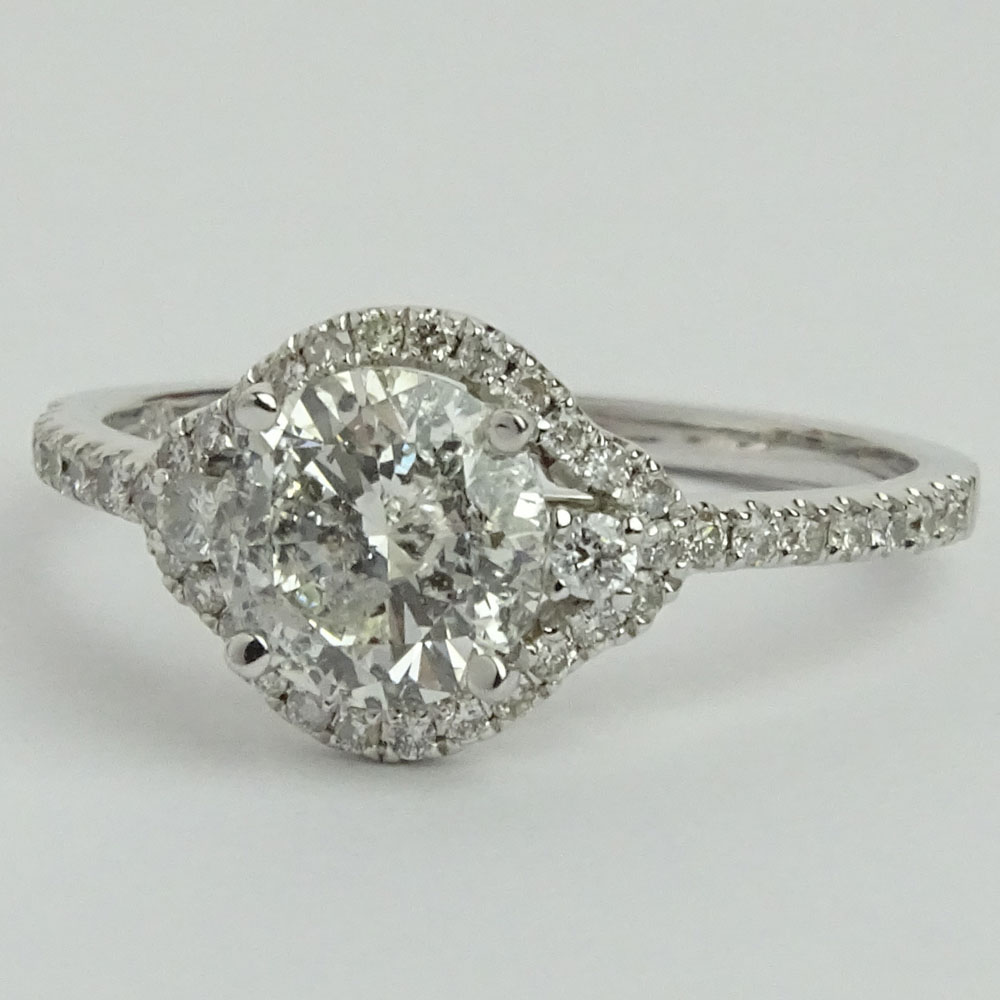 AIG Certified 1.04 Carat Round Brilliant Cut Diamond and 14 Karat White Gold Engagement Ring accented with .27 Carat Round Brilliant Cut Diamonds.