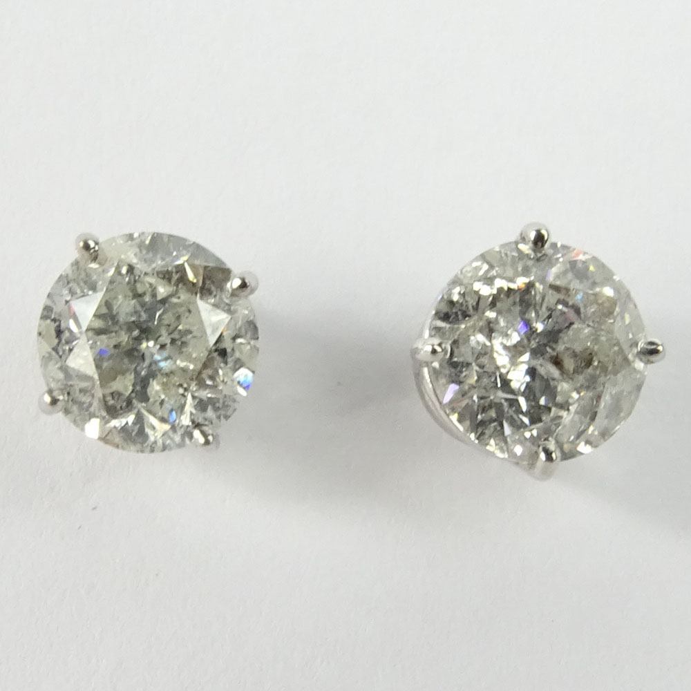 AIG Certified 3.17 Carat Total Weight Round Cut Diamond and 14 Karat White Gold Ear Studs.