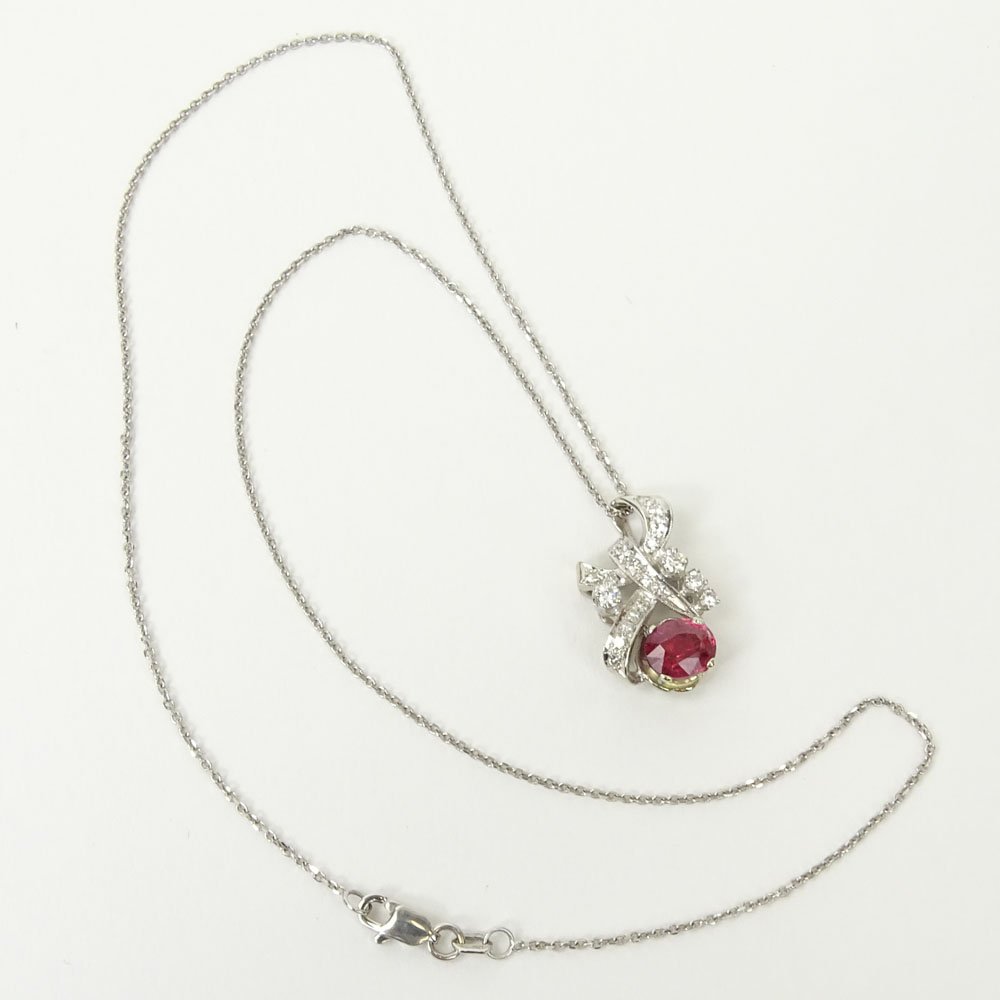 Vintage Oval Cut Ruby, Diamond and 18 Karat White Gold Pendant with 14 Karat White Gold Chain.