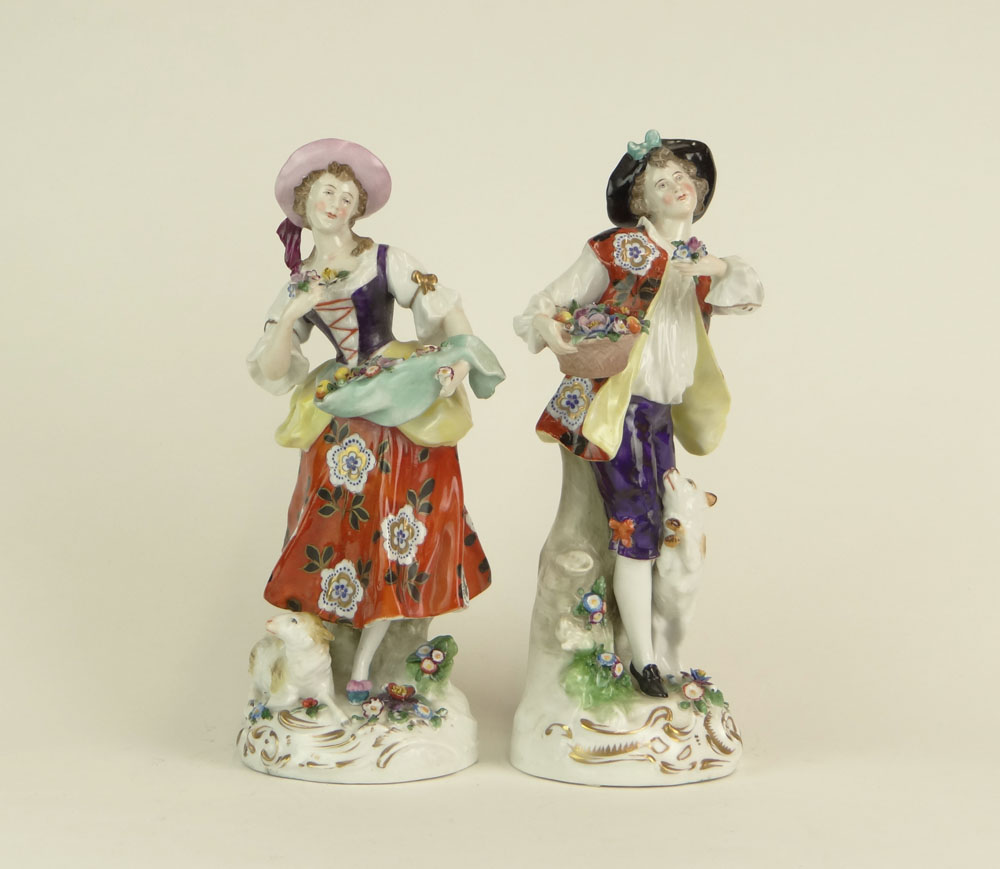 Pair of Antique English Chelsea Painted and Gilt Porcelain Figures.