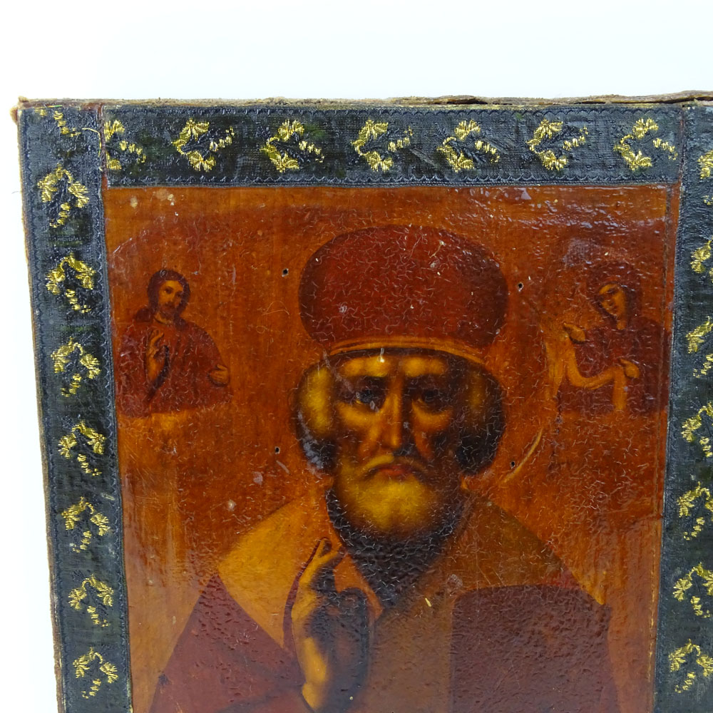 19th Century Hand Painted and Lacquered Russian Icon. Decorated with Cloth around the Exterior.