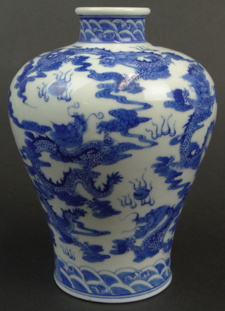 Chinese Blue and White Porcelain Vase with Dragon Chasing the Flaming Pearl Decoration.