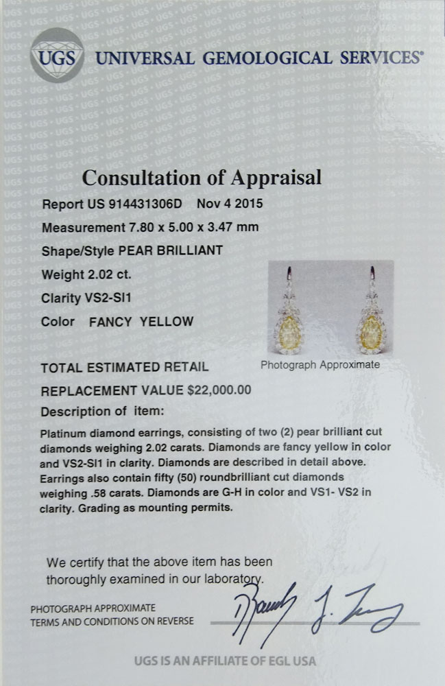 EGL Certified 2.02 Carat Pear Brilliant Cut Fancy Yellow Diamond and Platinum Earrings.