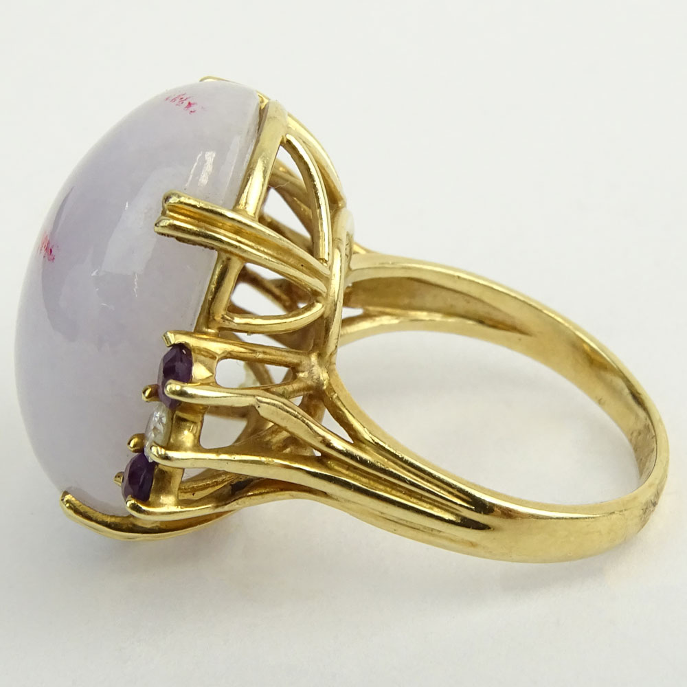 Vintage Lavender Jade and 14 Karat Yellow Gold Ring with Diamond and Sapphire accents.
