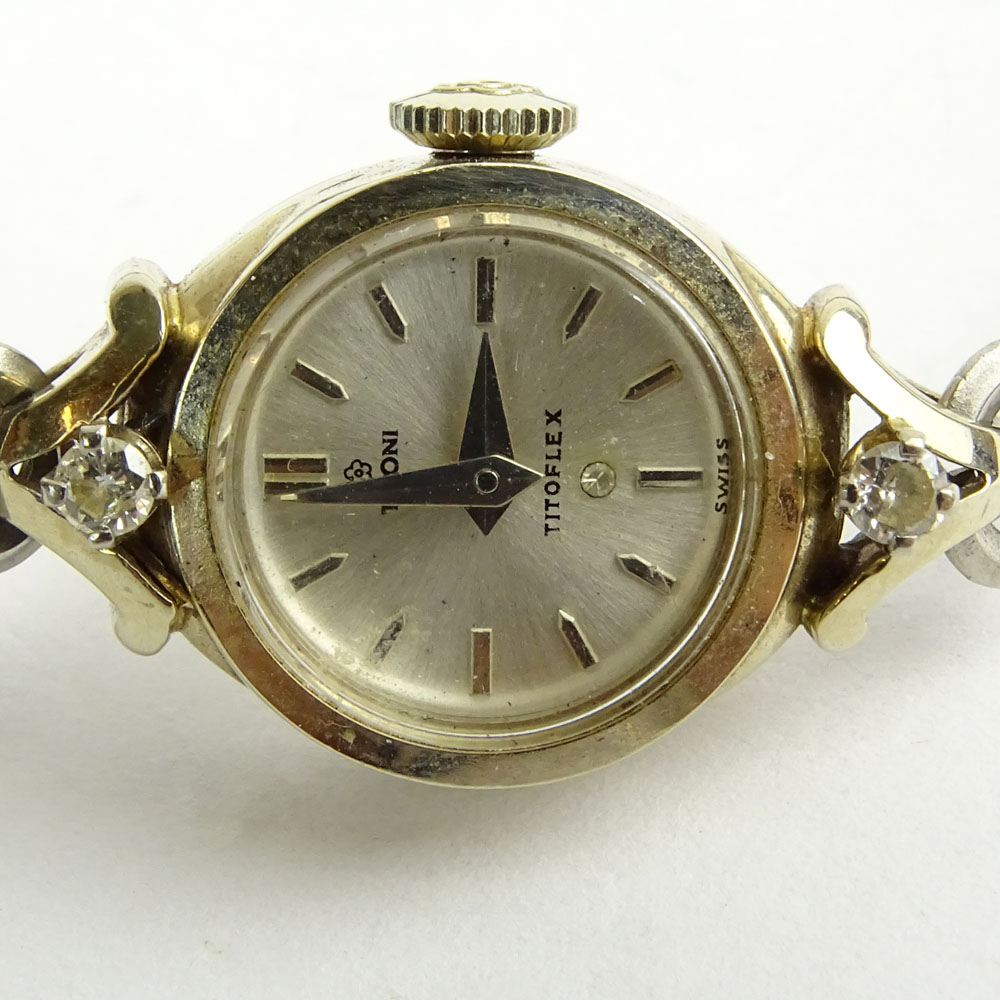 18 Karat White Gold and Diamond Tittoni Manual Movement Watch with Gold Filled Bracelet.