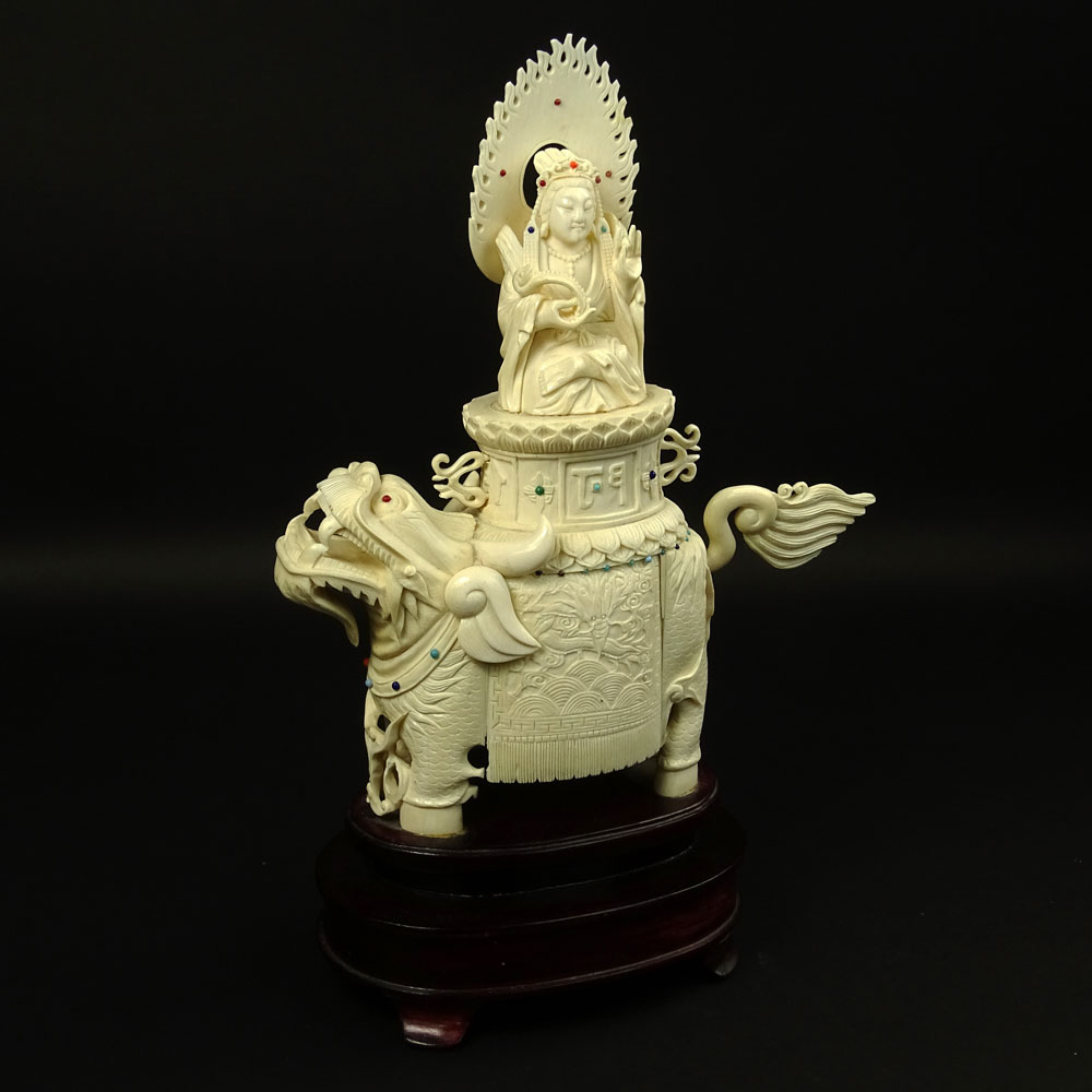 "Vintage Chinese Carved Ivory on Hardwood Stand ""Deity On Foo Lion"" Inset with turquoise and coral beads."