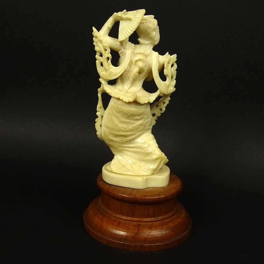 "Vintage Carved Ivory Figurine on Hardwood Stand ""Dancer""."