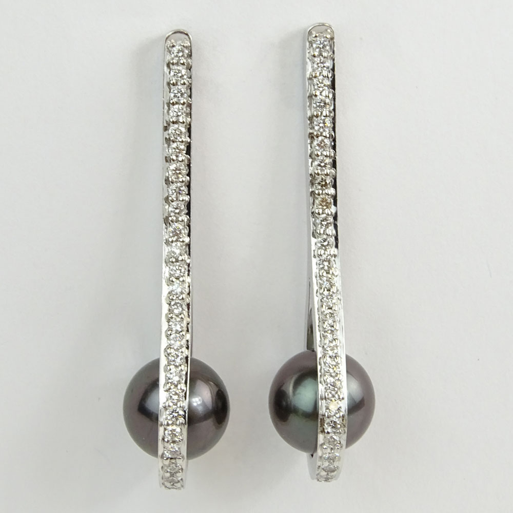 Pair of Lady's Silver Black Tahitian Pearl and 14 Karat White Gold Earrings