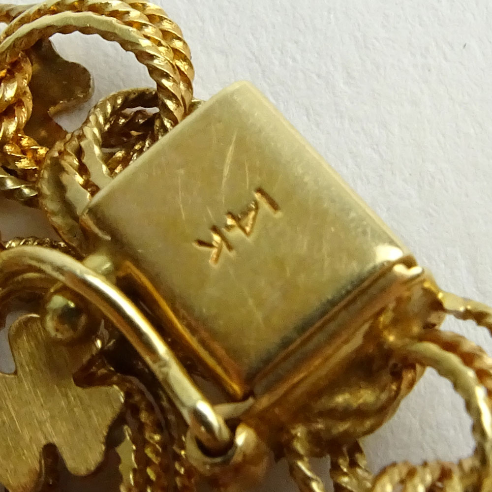 Vintage 14 Karat Yellow Gold Charm Bracelet with Four (4) Charms.