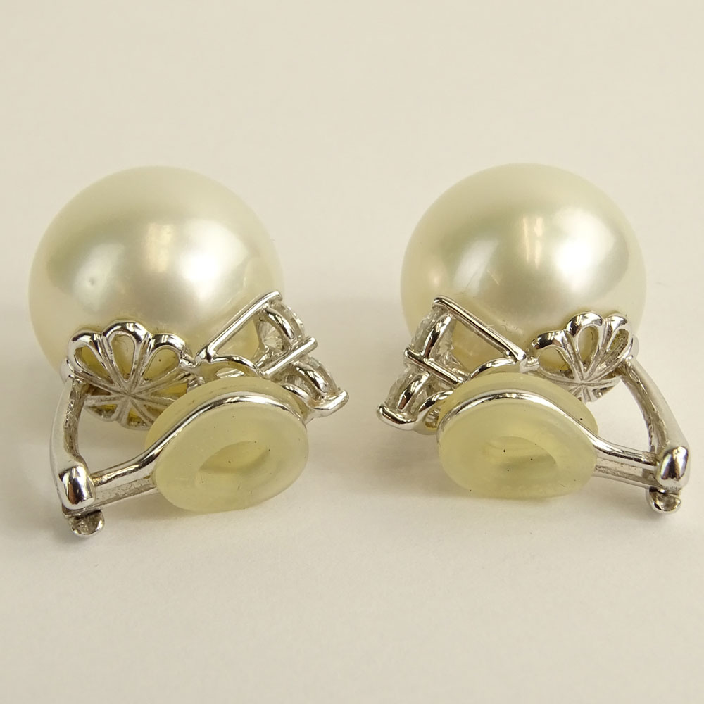 Pair of 15.6-15.9mm South Sea Pearl and 18 Karat White Gold Earclips with Three (3) Round Brilliant Cut Diamonds.
