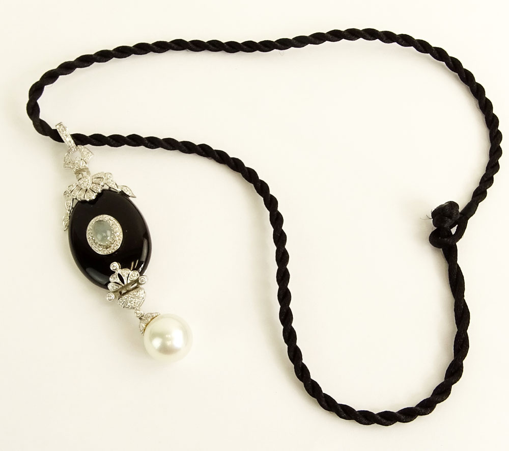 Modern Art Deco style South Sea Pearl, Black Onyx, 18 Karat White Gold Pendant accented with small round cut diamonds.
