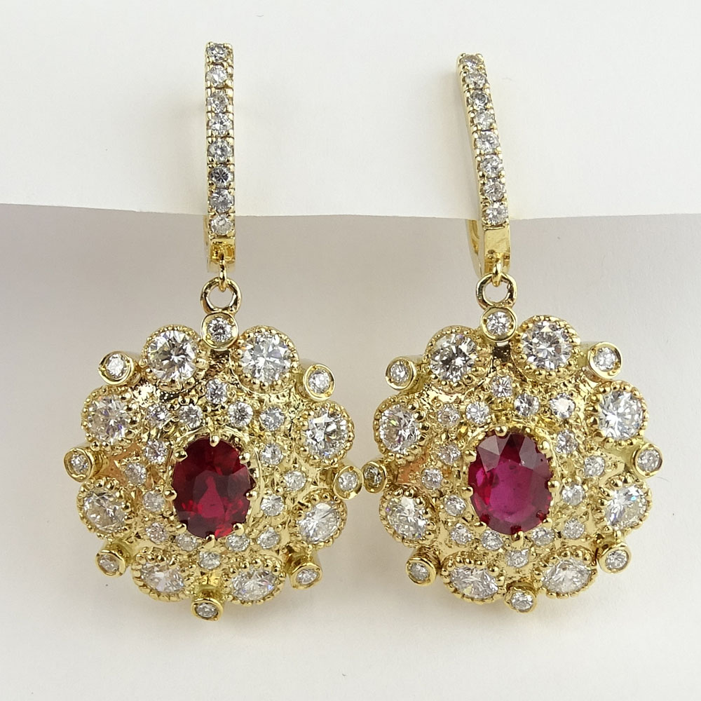 2.50 Carat Oval Cut Ruby, 7.00 Carat Round Cut Diamond and 14 Karat Yellow Gold Earrings.