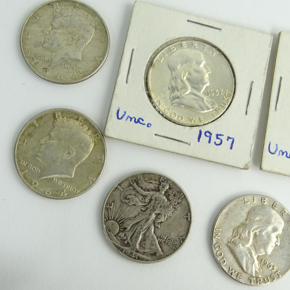 Lot of Eight (8) Half Dollar Coins.