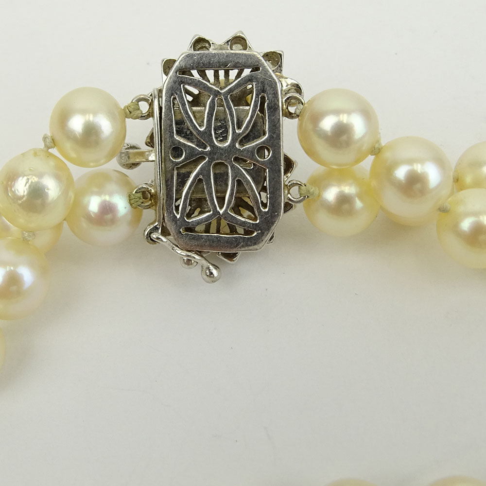Vintage Double Strand White Pearl Necklace with 14 Karat White Gold and Diamond Clasp.