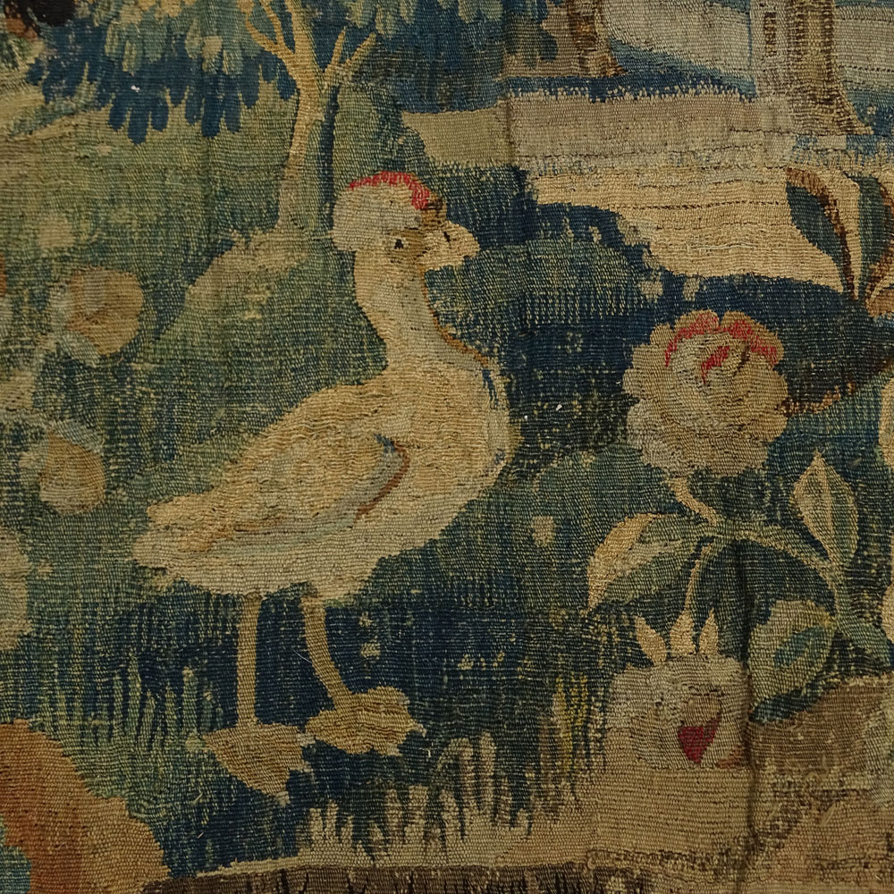 Large 17/18th Century Flemish Tapestry. Scene depicting a tree in landscape with buildings and animals. Lined.