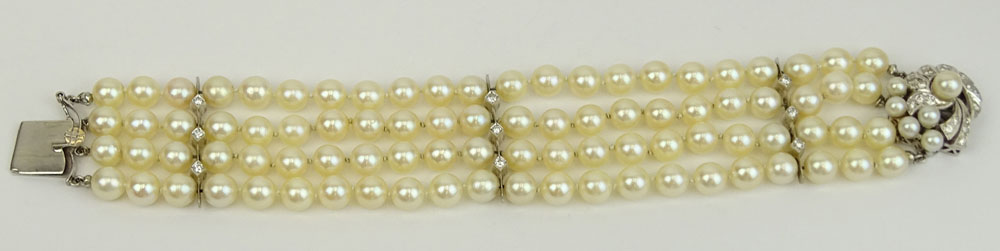 Vintage Four Strand Pearl, Diamond and 14 Karat White Gold Bracelet.