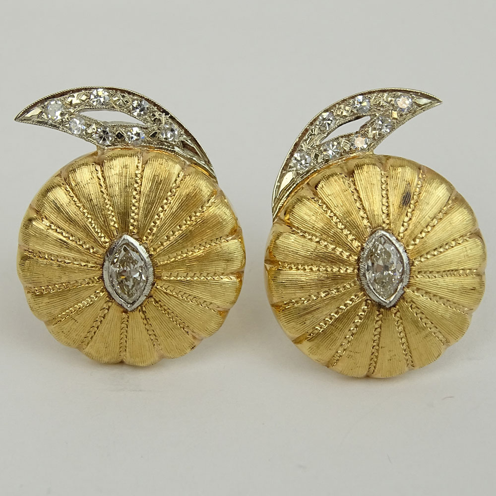 Pair of Vintage 14 Karat Yellow Gold Button style Earrings Set with Approx. 1.20 Carat Marquise Cut Diamonds and further accented with Round Brilliant Cut Diamonds.