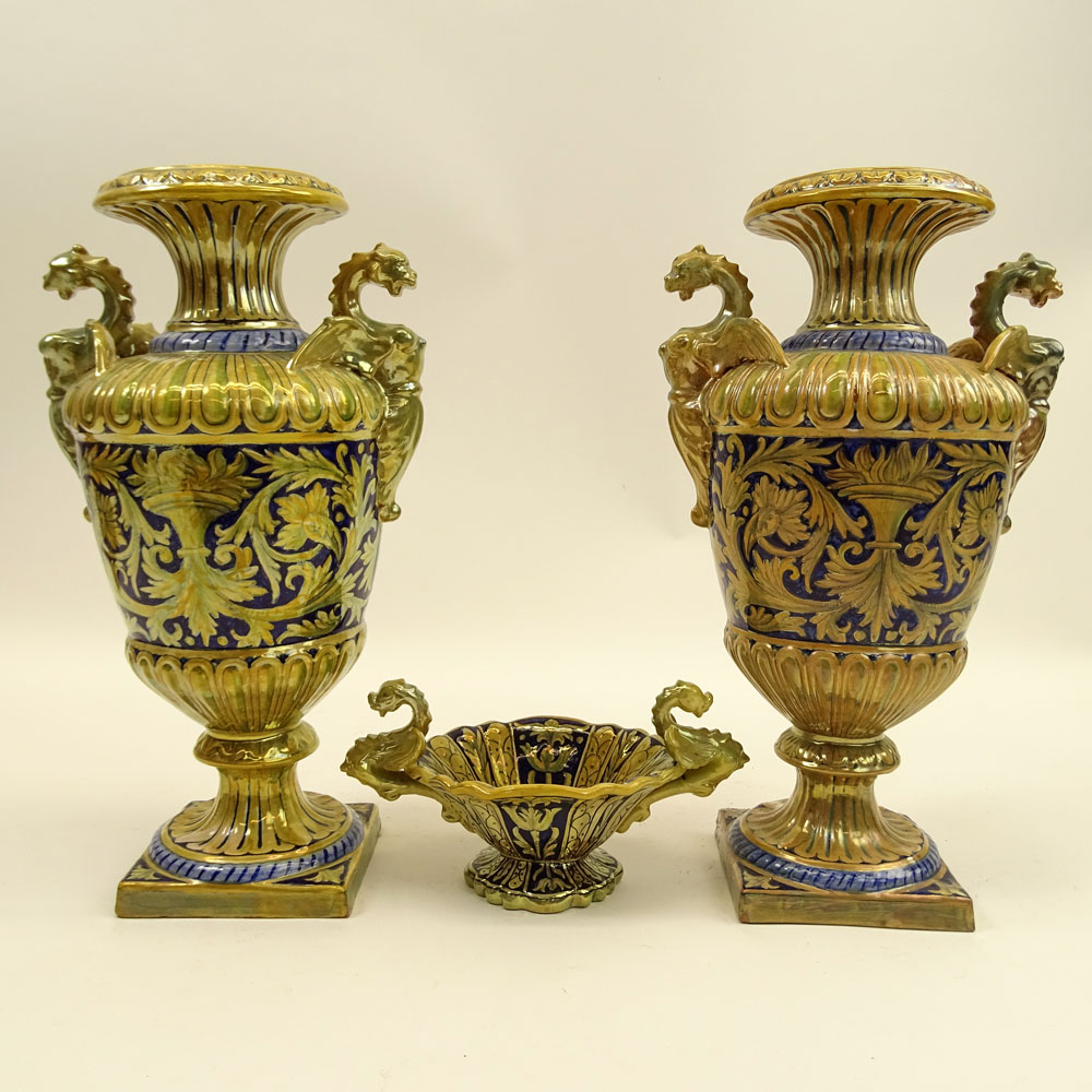 Three Pieces Early 20th Century Robbia Gualdo Tadino Painted Majolica Urns and compote. Chimera handles.