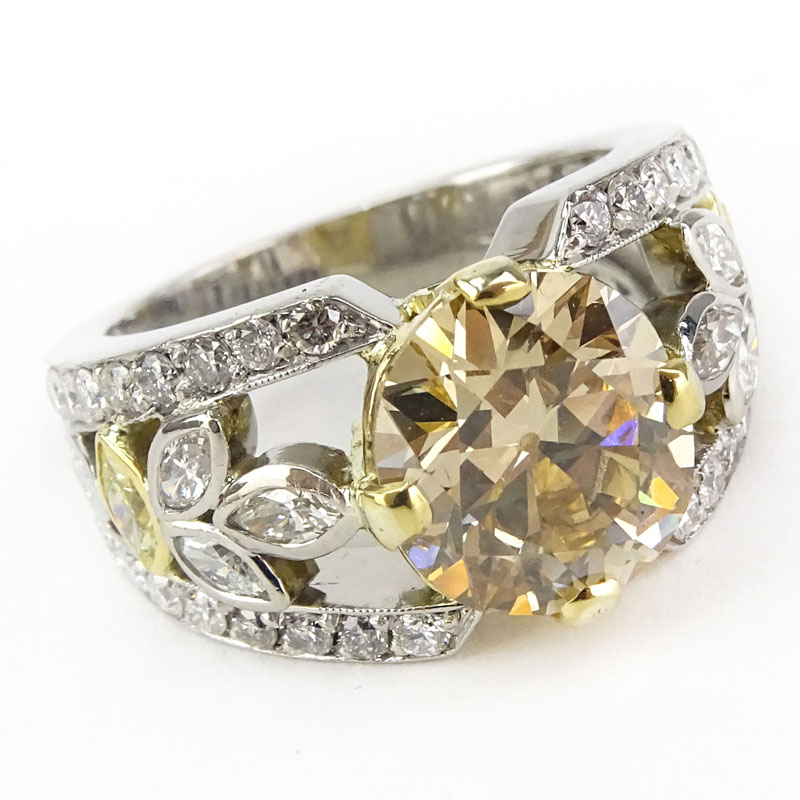 GIA Certified 4.04 Carat Fancy Brownish Yellow Diamond and Platinum Engagement Ring .