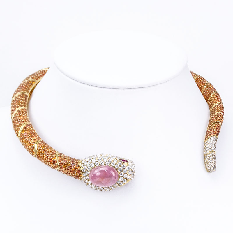 Finely Made Contemporary Approx. 8.60 Carat Pave Set Round Brilliant Cut Diamond, 20.0 Carat Cabochon Pink Sapphire, 80.10 Carat Pave Set Orange Sapphire and 18 Karat Yellow Gold Articulated Snake Hinged Choker Necklace.