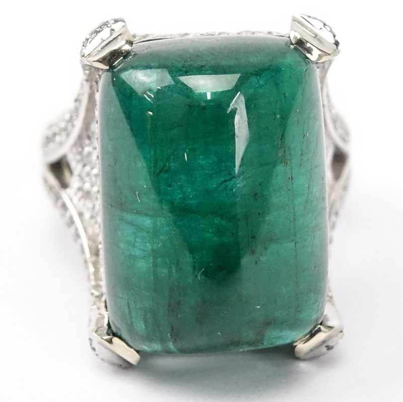 GIA Certified 25.59 Carat Sugarloaf Cabochon Emerald, Approx. 3.70 Carat Pave Set Diamond and 18 Karat White Gold Ring.