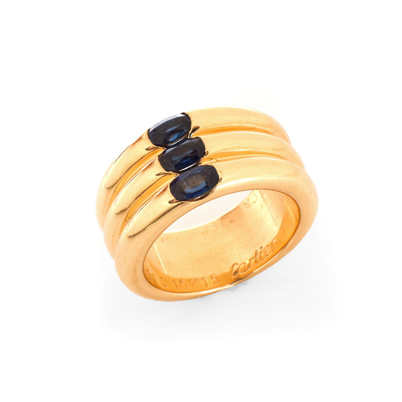 Cartier Approx. 1.10 Carat Oval Cut Sapphire and  18 Karat Yellow Gold 10mm Triple Stack Band Ring.