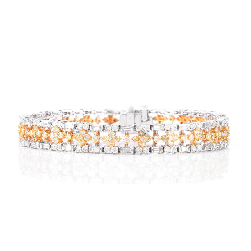 Approx. 3.90 Carat TW Round Brilliant and Baguette Cut White Diamond, 3.25 Carat Round Brilliant Cut Fancy Yellow Diamond and 18 Karat White Gold Bracelet.