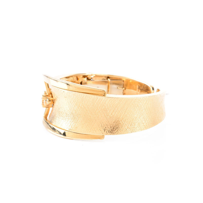 14 Karat Yellow Gold and Ten (10) Round Brilliant Cut Diamond Cuff Bangle Bracelet.