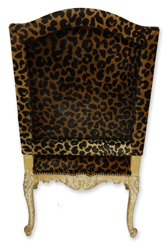 Vintage Cow-Hide Upholstered and Carved Wood Fauteuil Chair. Stencil cheetah print on upholstery and distressed floral carved frame.