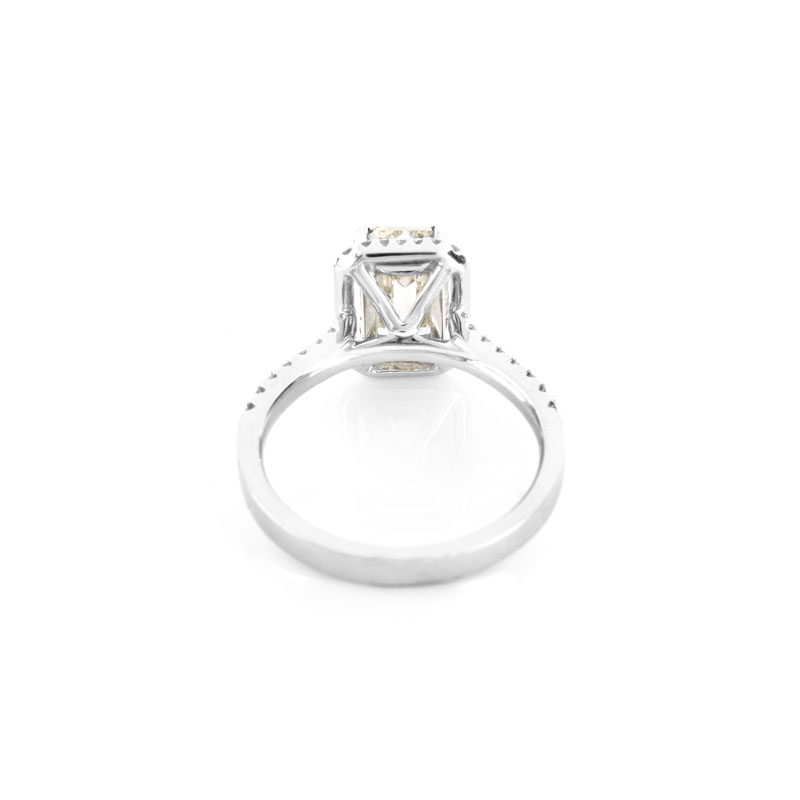 Approx. 2.10 Carat Emerald Cut Diamond and 18 Karat White Gold Engagement Ring accented throughout with Round Brilliant Cut Diamonds.