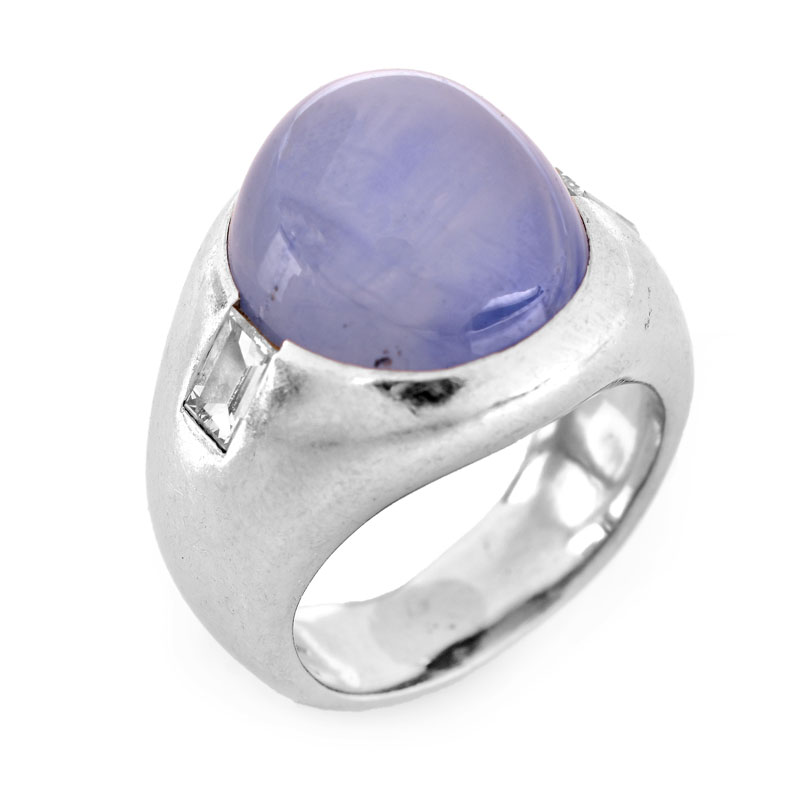 Approx. 15.0 Carat Oval Cabochon Star Sapphire, .70 Carat Emerald Cut Diamond and Platinum Ring.