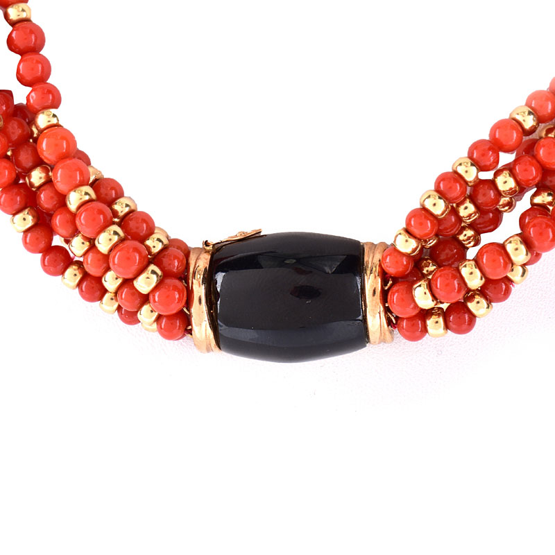 Vintage Red Coral and 14 Karat Yellow Gold Bead Multi Strand Necklace with Onyx and 14 Karat yellow Gold Clasp.