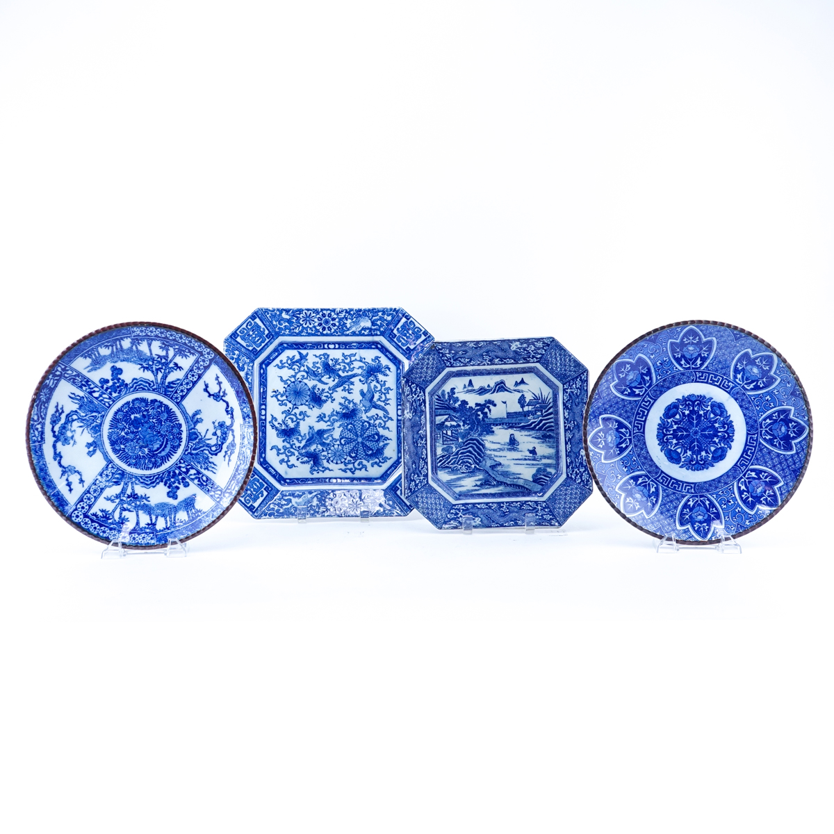 Four (4) Chinese Blue & White Pottery Chargers. Unsigned.