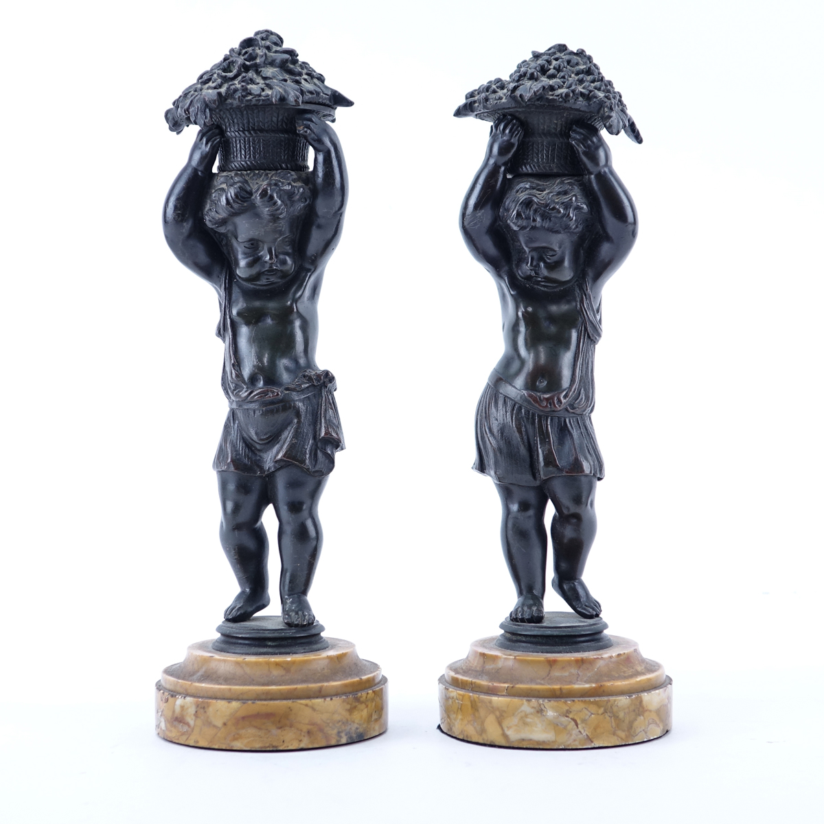 Pair of 19/20th Century Continental Bronze Putti Figures With Baskets on Sienna Marble Bases. Unsigned.