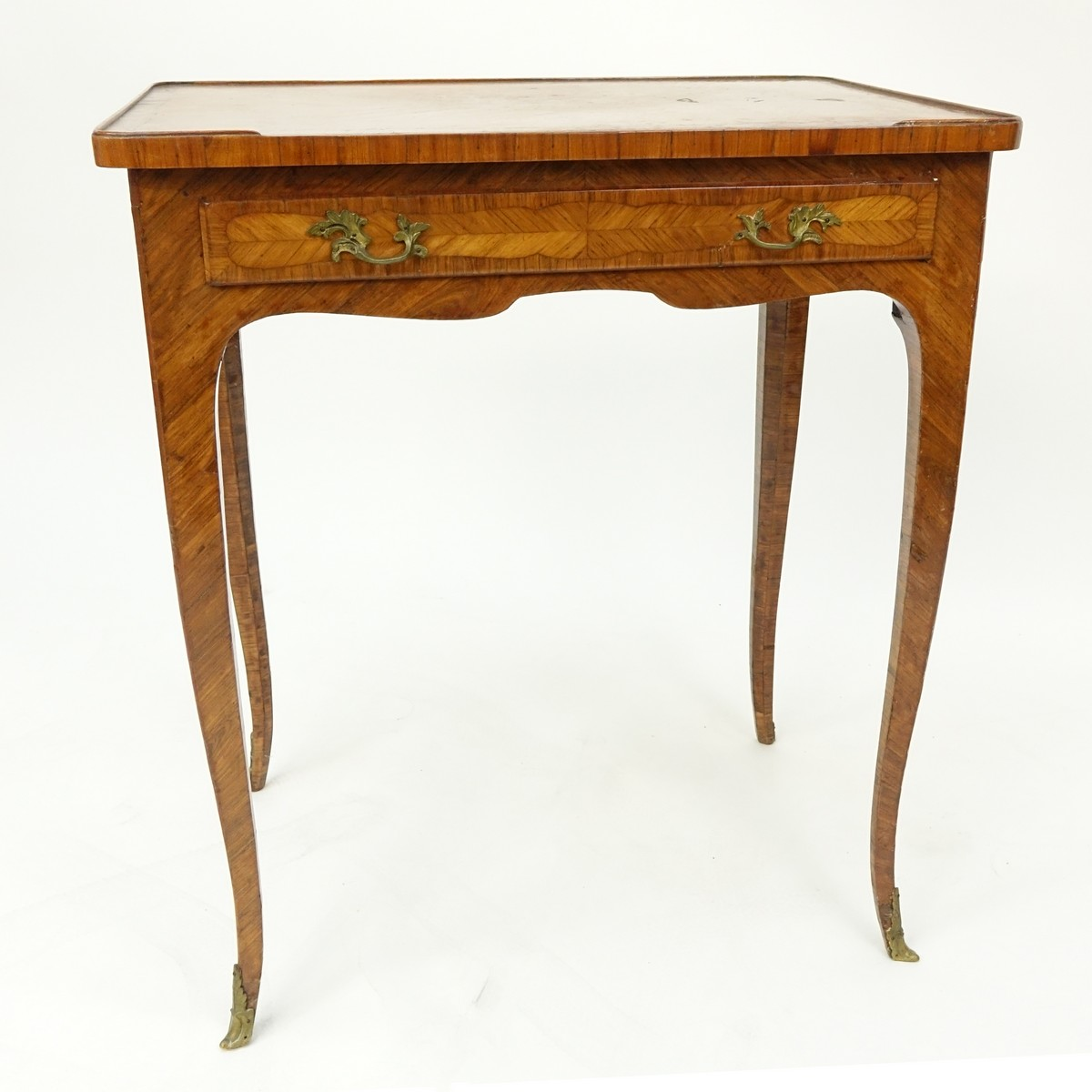 19th Century French Kingwood Inlaid Side Table with Gilt Bronze Mounts. Large sliding drawer and stands on tapering cabriole legs.