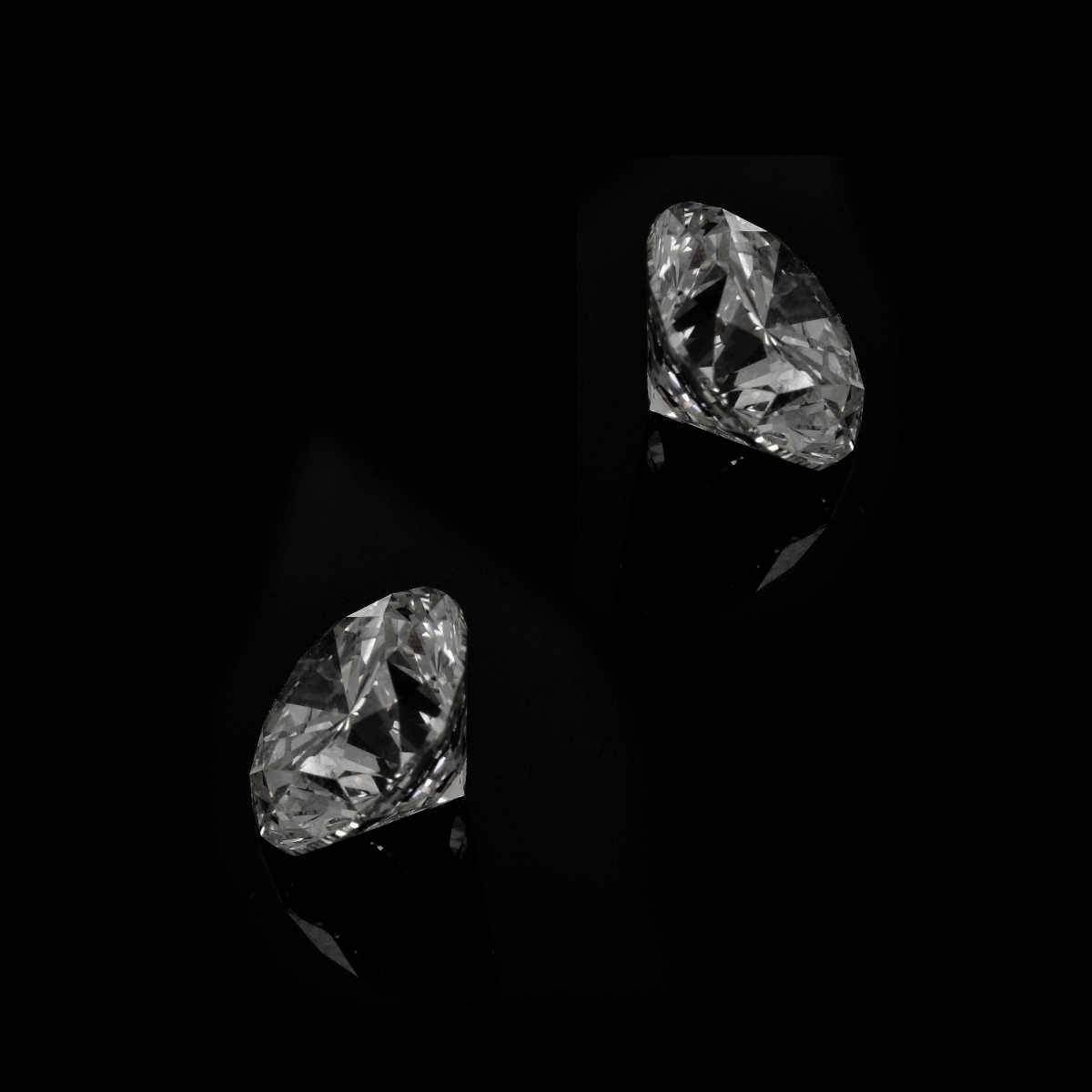 Two (2) GIA Certified 6.14ct TW Diamonds