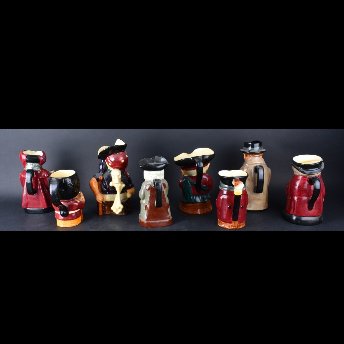 Grouping of Eight (8) Toby Jugs