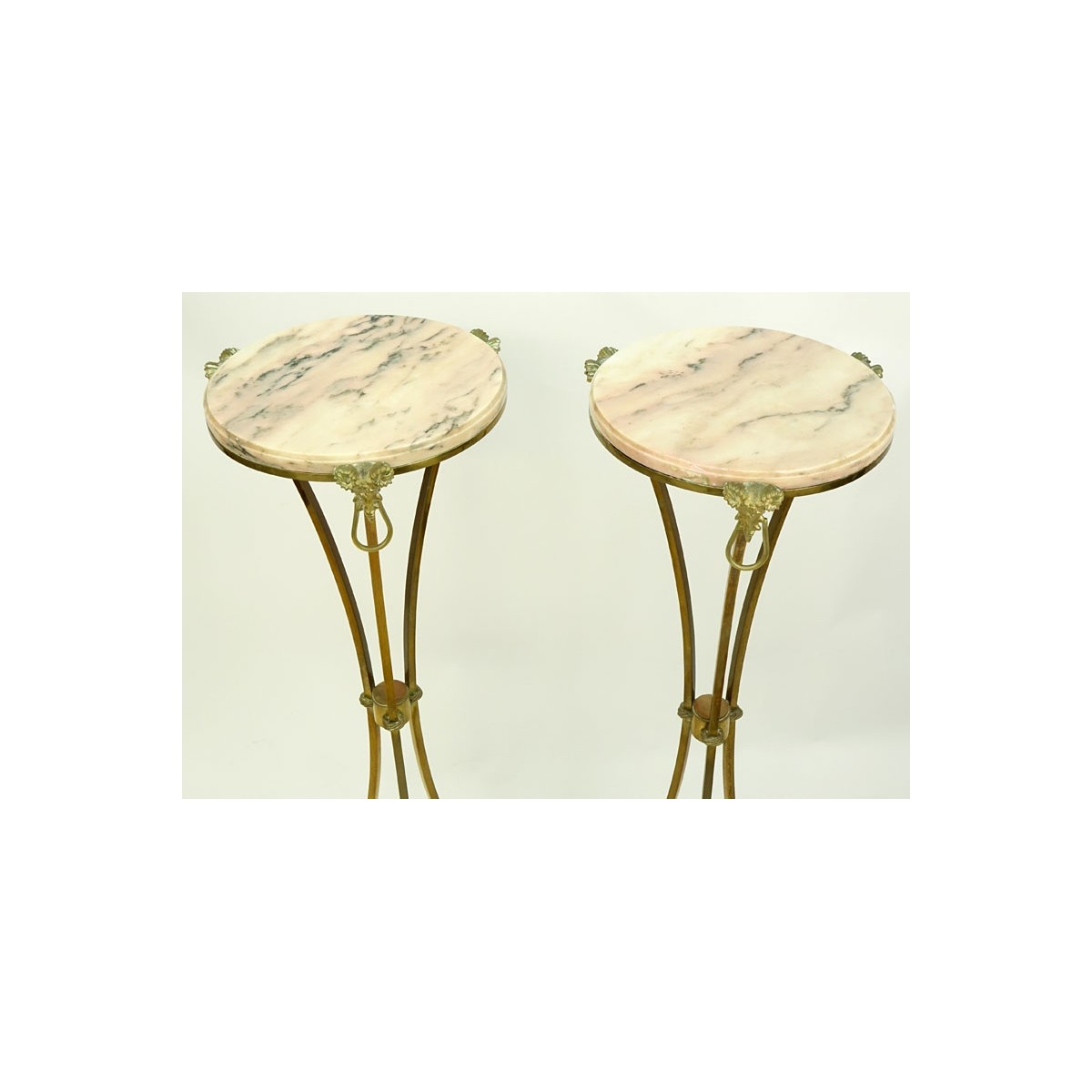 Pair of Marble Top Maison Jansen Style Brass Pedestal Tables. Rams head fittings standing on hoof f