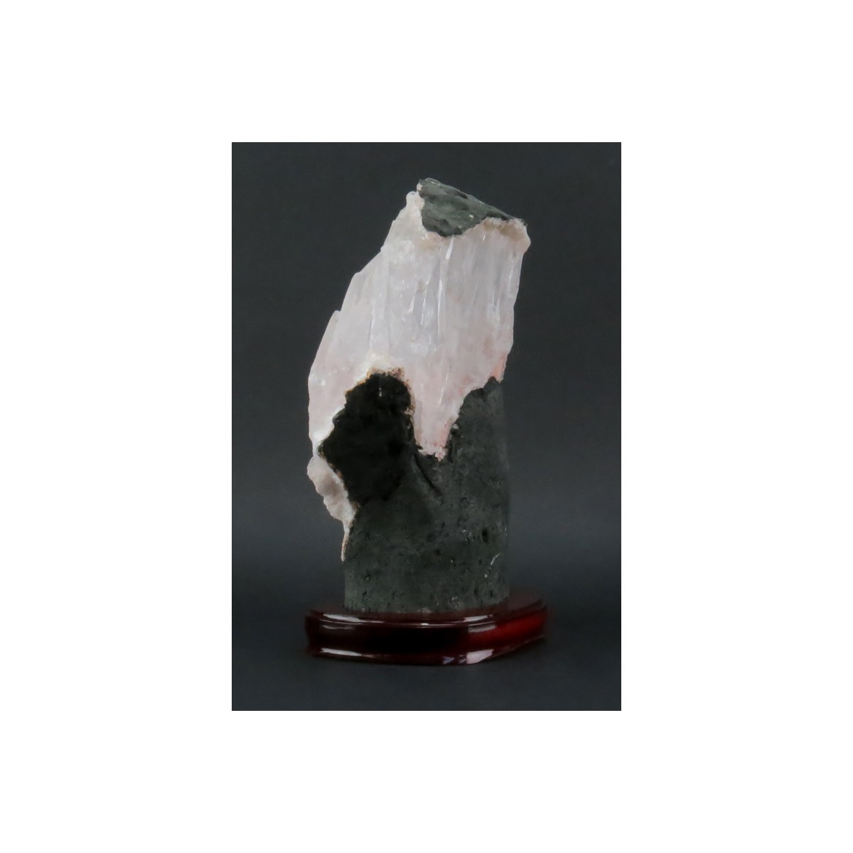 Rock Quartz Lapidary Specimen on Wooden Stand. Clear to rose color shades and various structures. N
