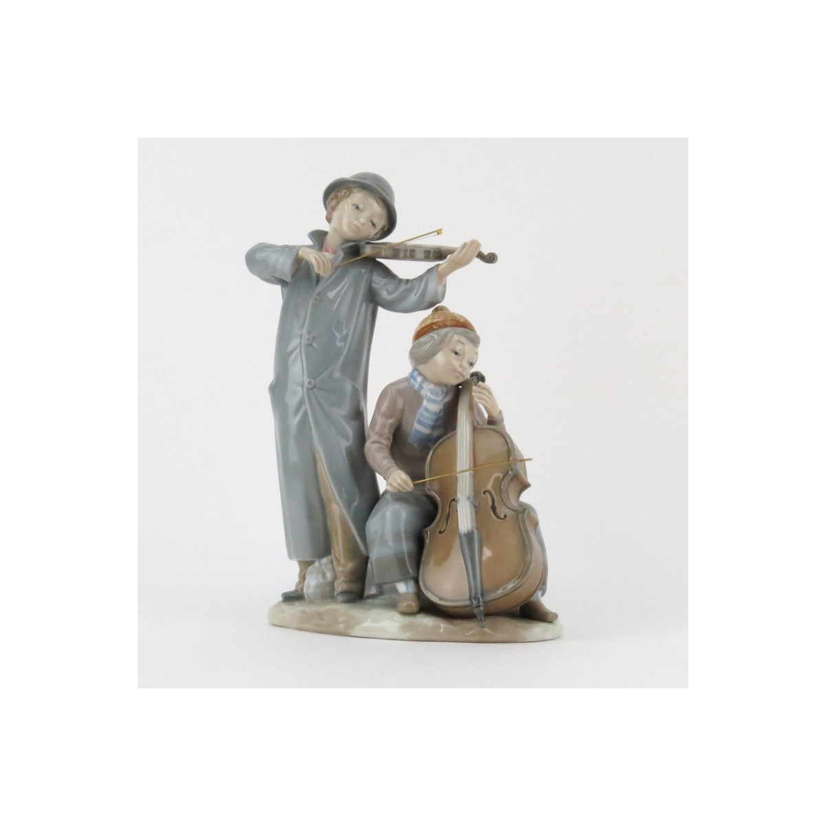 Zaphir Lladro Style Young Musicians Porcelain Grouping. Signed and artist signed Jose Puche, marked