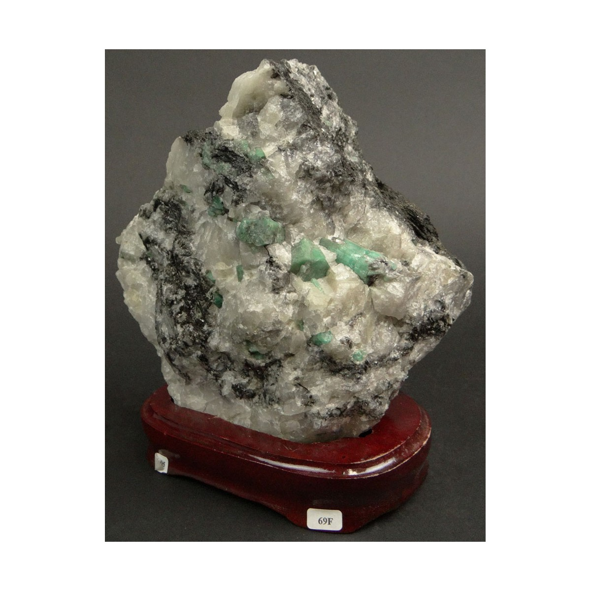 Mineral Specimen with Emeralds Mounted on Wooden Base. Measures 6-7/8 Inches by 6-1/2 Inches. Measu