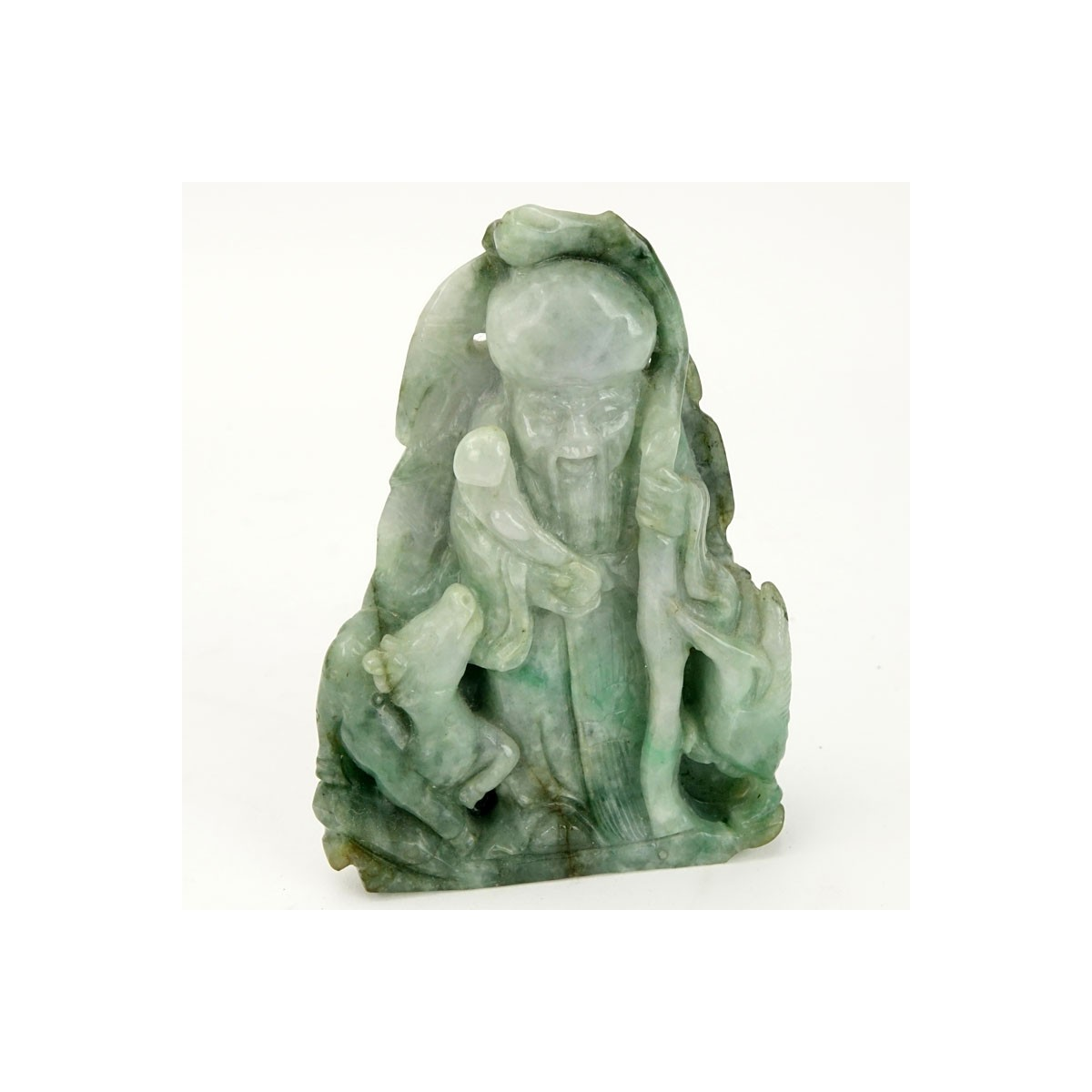 Chinese Carved Jade Shou Lao Figurine. Depicted holding staff and scepter. Light to dark green in c