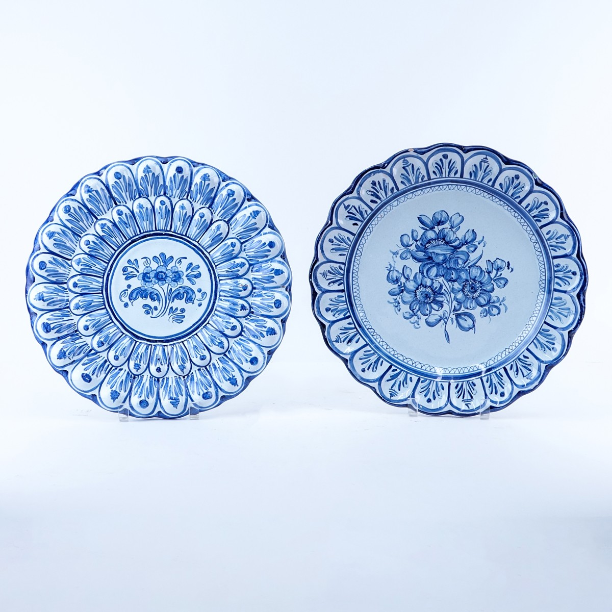 Two (2) Large Faience Pottery Chargers. Each signed to base. One has been restored, chips to rim on