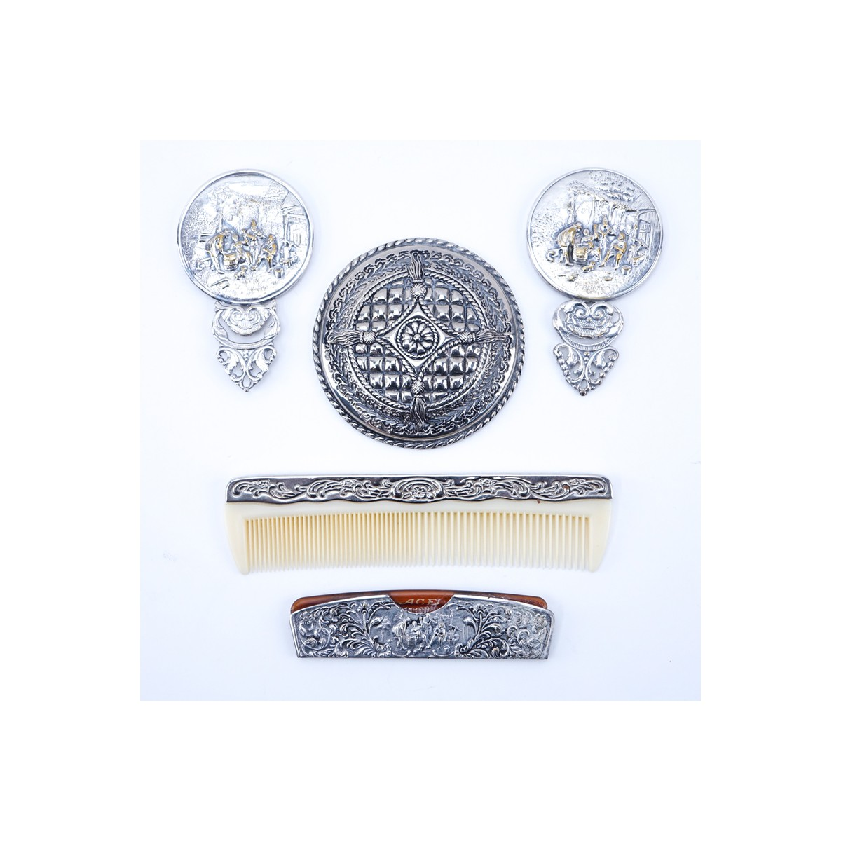 Collection of Five (5) Repousse Silver Plated Vanity Items. Includes: two combs and three mirrors.