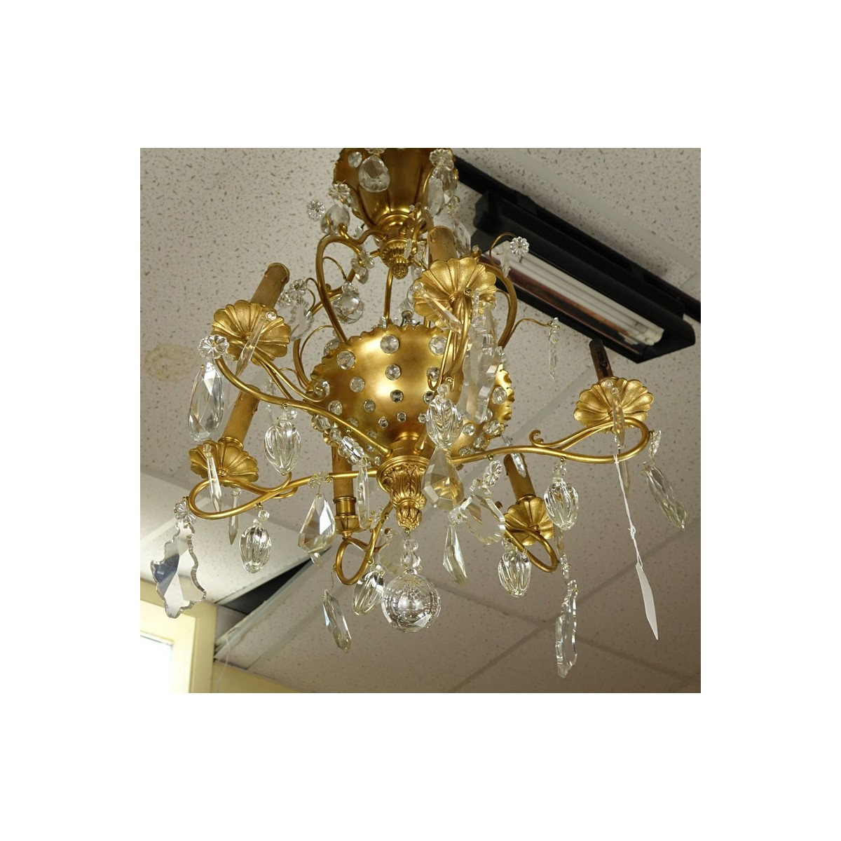 Late 19th/Early 20th Century Rococo Style Gilt Bronze and Crystal 6-Arm Chandelier. Decorated with