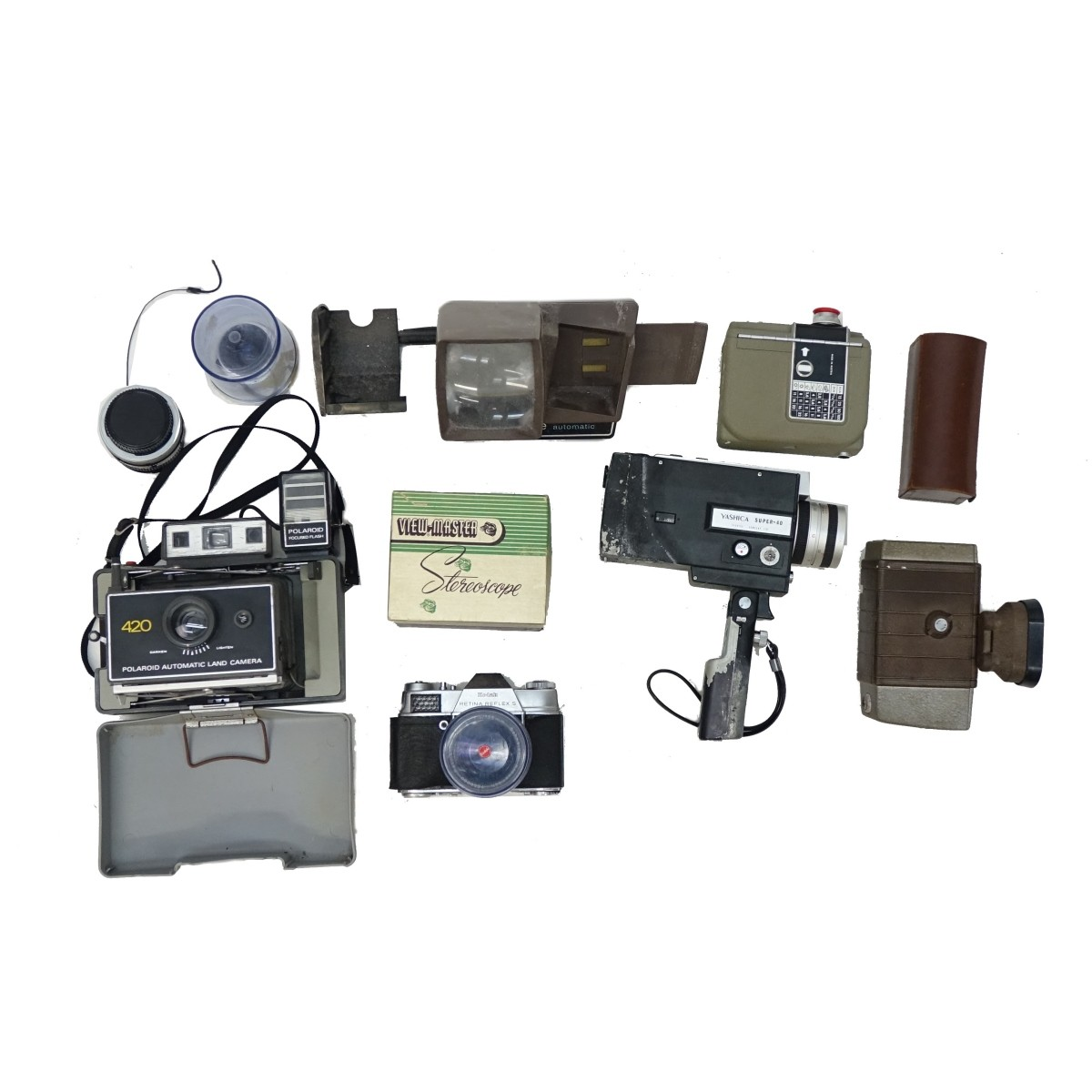 Assorted Cameras, Lenses, and Equipment.