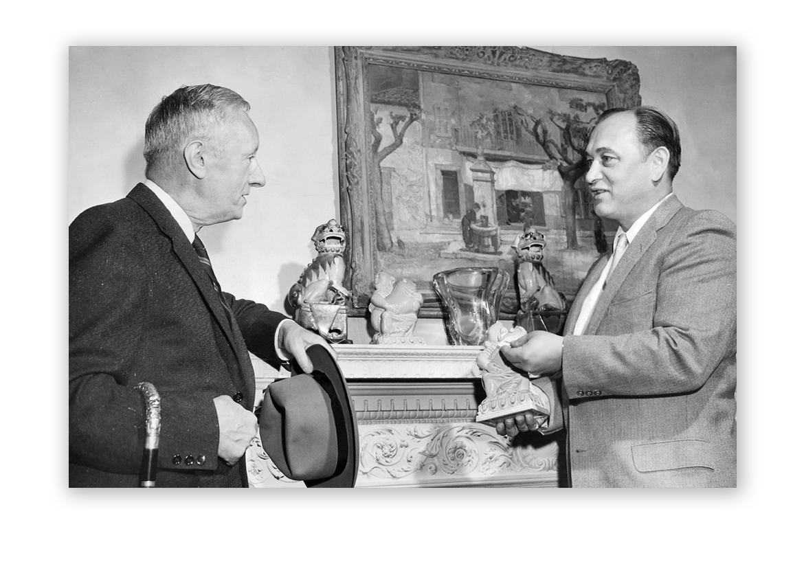 1958: Al Kodner speaking with art collector George T. Foster.