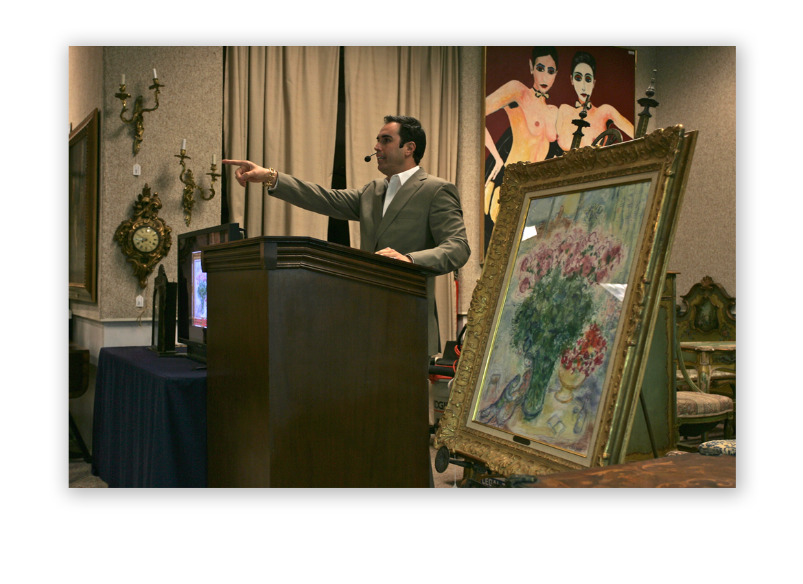2010: Russ Kodner at the auctioneer podium as a Marc Chagall painting sells at Kodner.