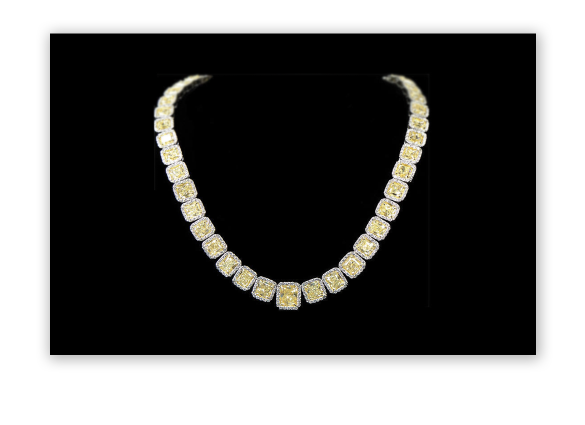 2013: 56.62 Carat Yellow Diamond Necklace hammers at $180,000 on December 18, 2013.